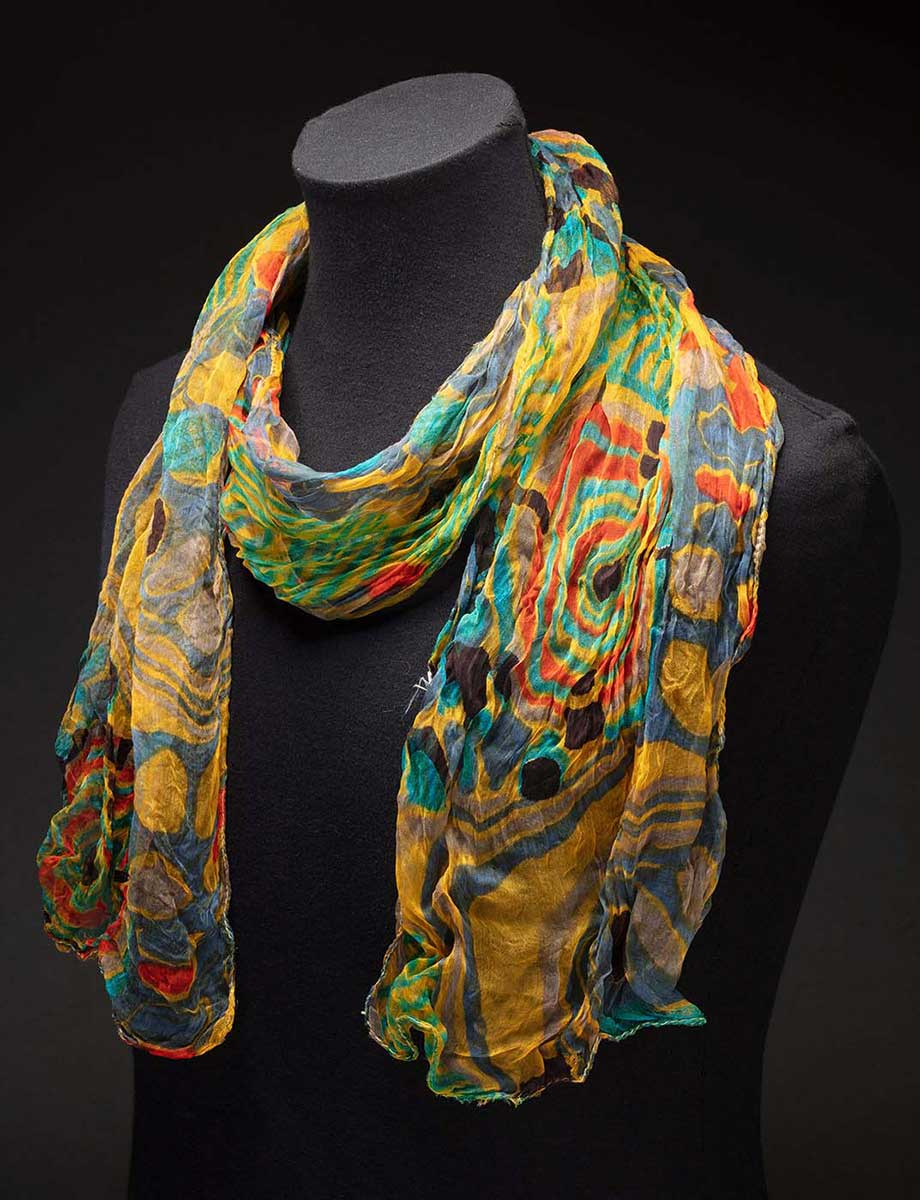 Jackie Huggins' multi-coloured scarf. - click to view larger image