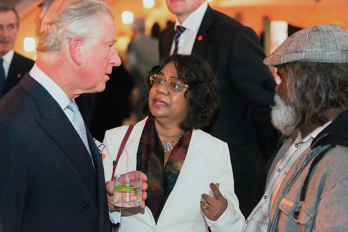 HRH Prince Charles speaking with two Indigenous people - click to view larger image