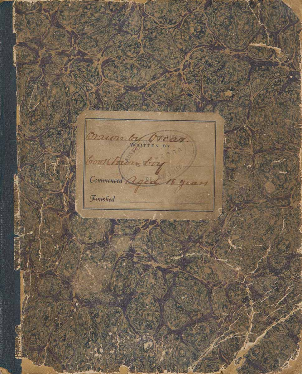 An exercise book with marbled paper on the front and the back covers, and a green fabric spine. A label attached to the front cover reads, Drawn by Oscar. Cooktown boy. Aged 18 years. - click to view larger image