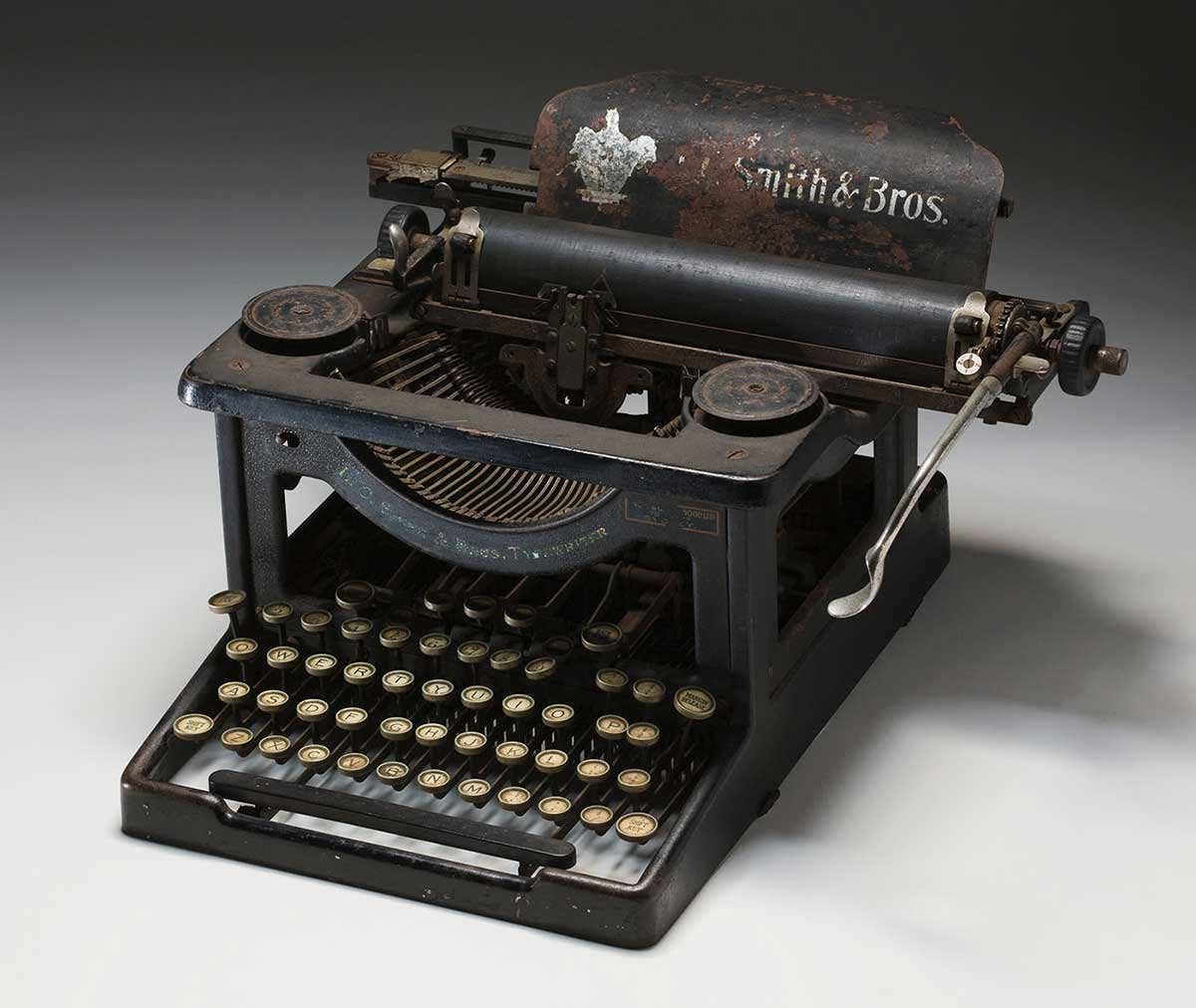 Antique typewriter with faded logo of L.C. Smith & Brothers. - click to view larger image