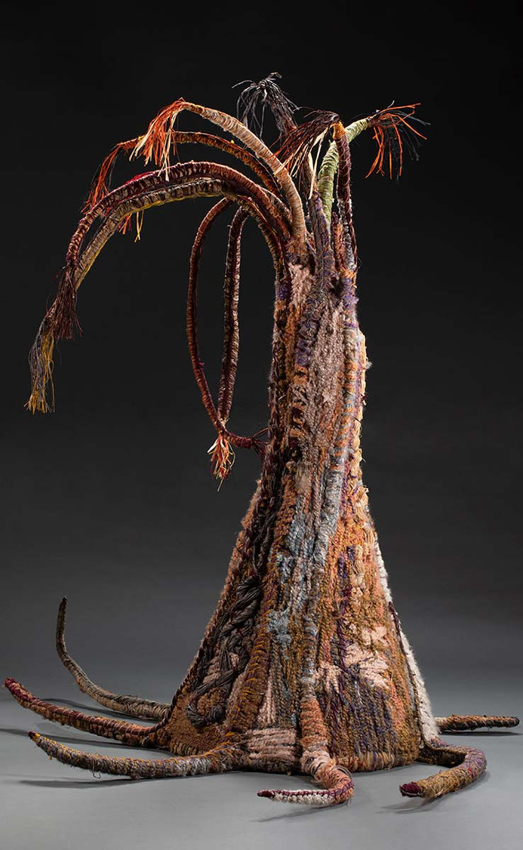 A tree sculpture with various materials including minarri grass, raffia, acrylic wool and jute twine. - click to view larger image