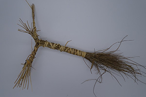 A  bunch of straight twigs wrapped with twine.