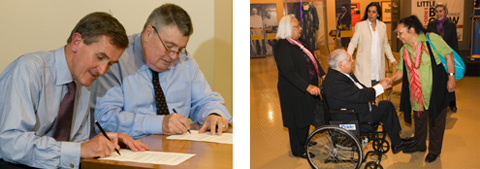 Two colour photographs side by side. The photograph on the left shows Neil MacGregor and Craddock Morton sitting at a table signing documents. The photograph on the right shows a group of five people. In the foreground a woman shakes the hand of a man sitting a wheelchair. Three women are in the background.