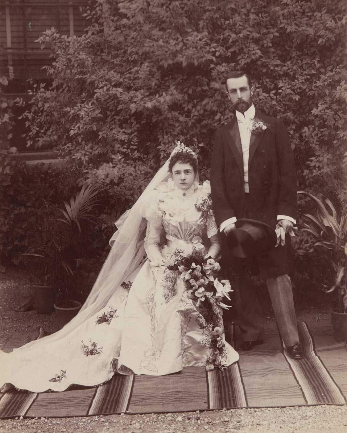 A black and white photo of Lilian Faithfull and William Hugh Anderson at Springfield homestead on their wedding day. - click to view larger image