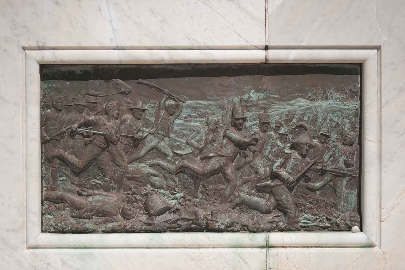 Bronze frieze featuring a battle scene. - click to view larger image