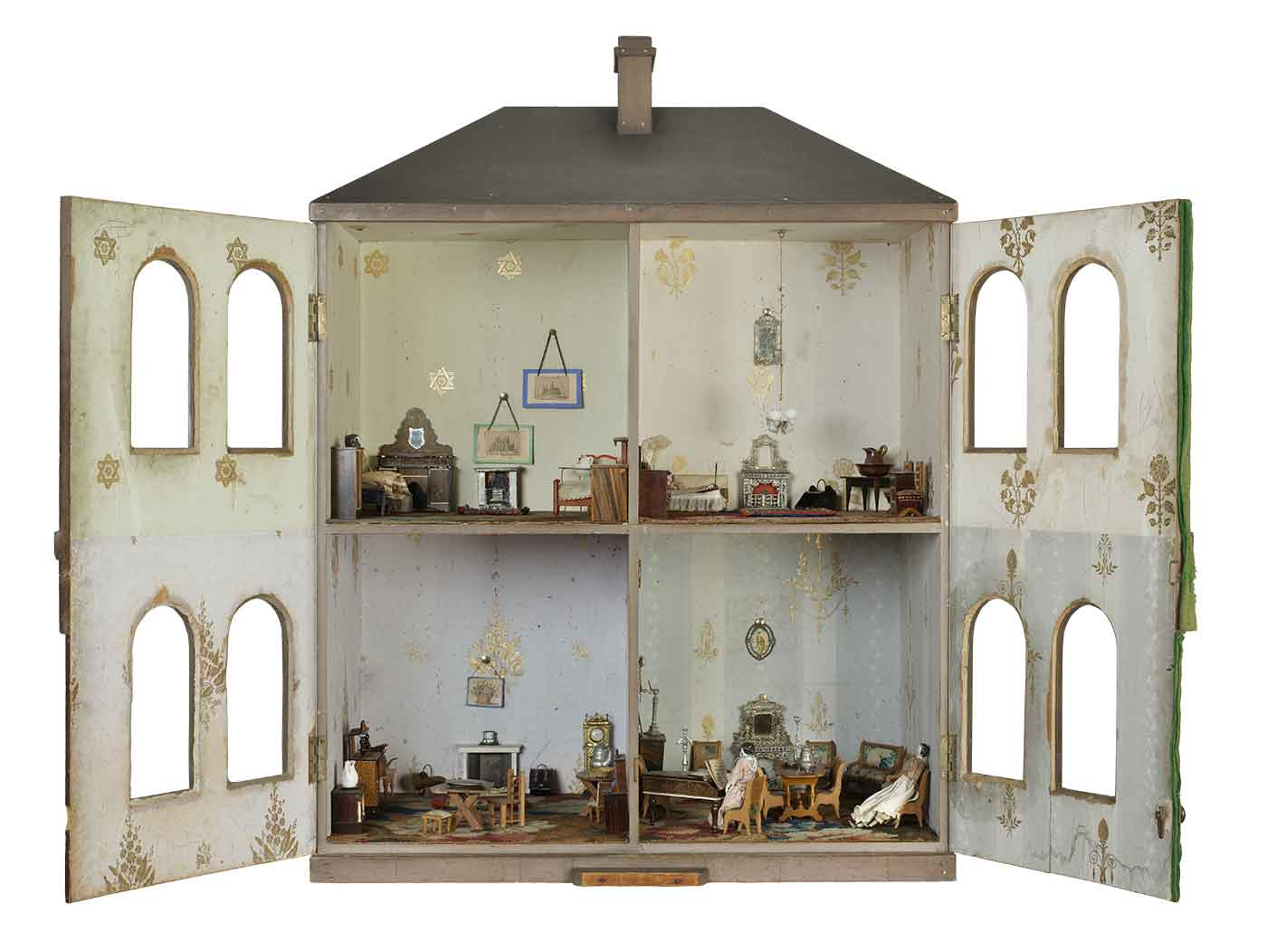 19th Century dollhouse featuring four rooms with miniature furniture, people and decor.