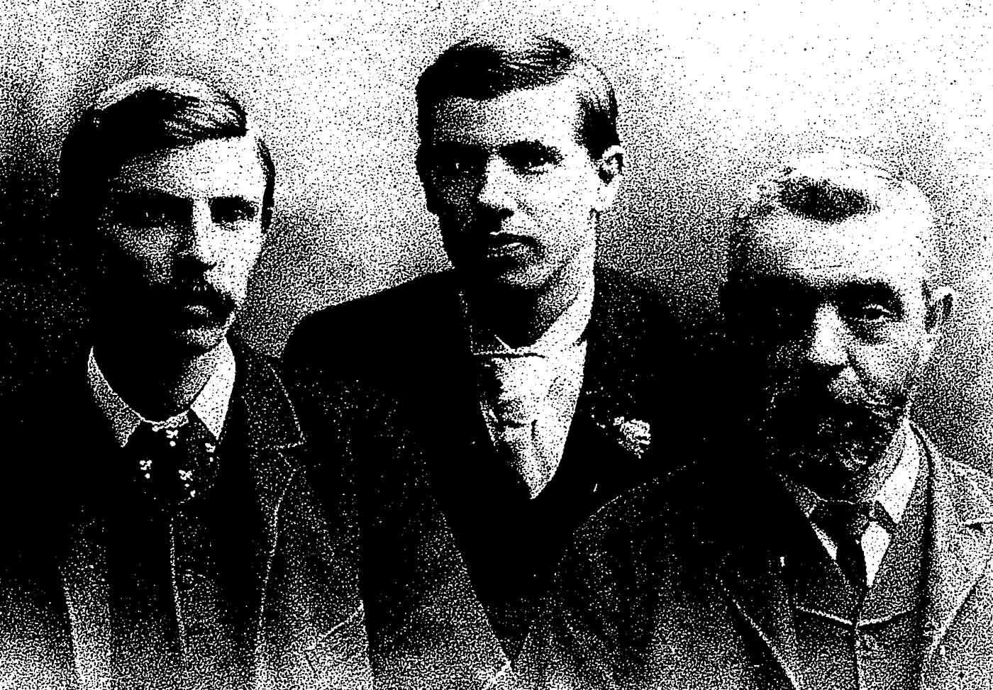 Black and white photo portrait of an older man and two younger man. - click to view larger image