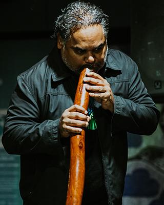 A portrait photo of Ben Ferguson, Aboriginal Cultural Programs Coordinator at Saltwater Freshwater Arts Alliance.