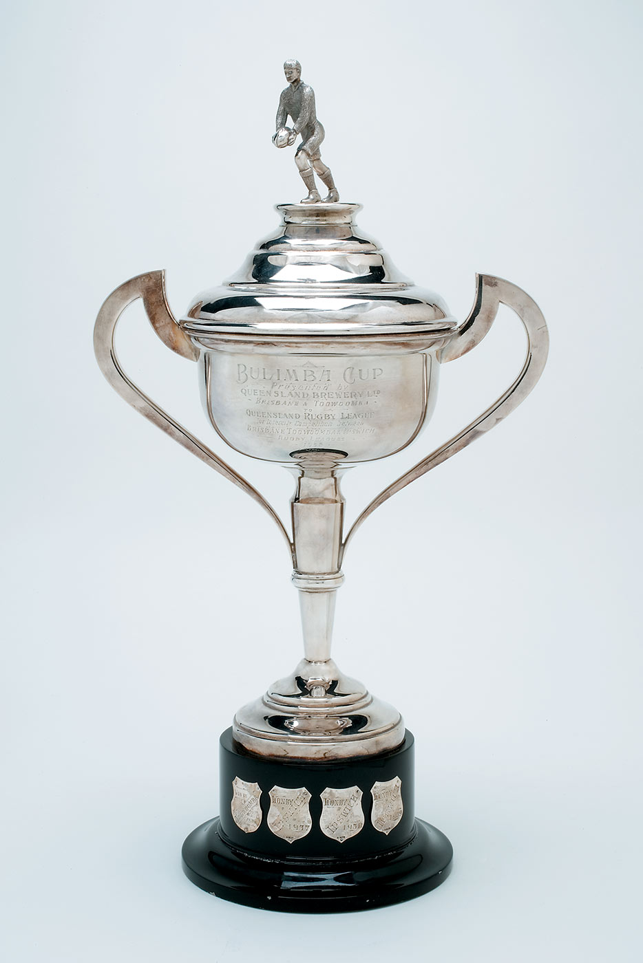 Silver presentation cup topped by a silver footballer preparing to kick a ball. - click to view larger image