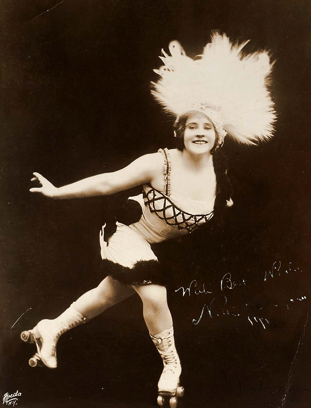 A black and white photo of Nellie Donegan on rollerskates.