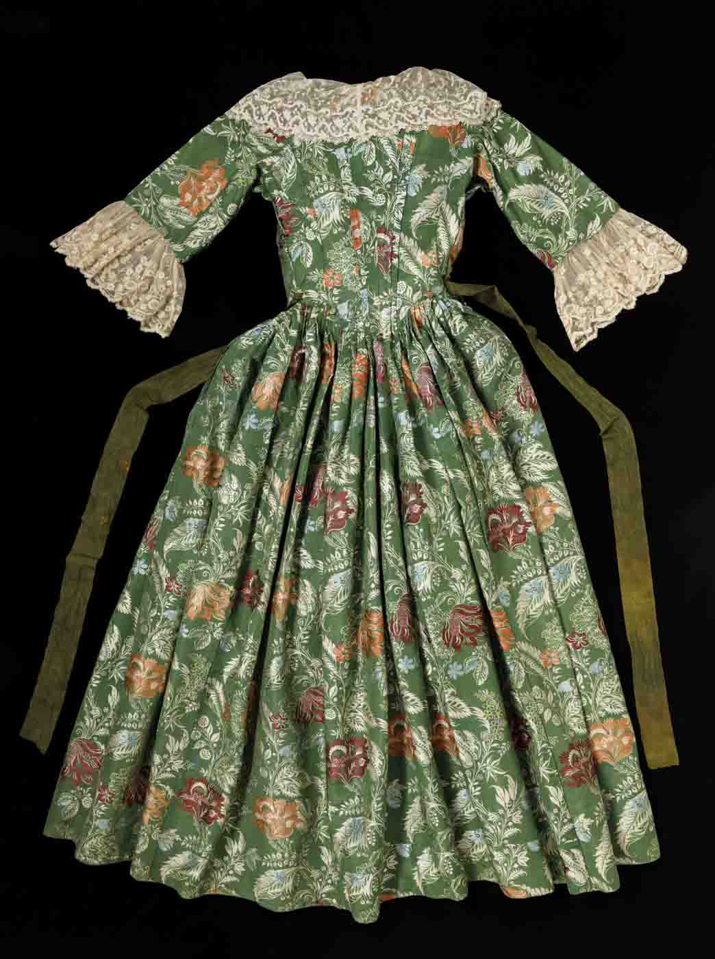Green and floral dress with lace trim on the neckline and sleeves - click to view larger image