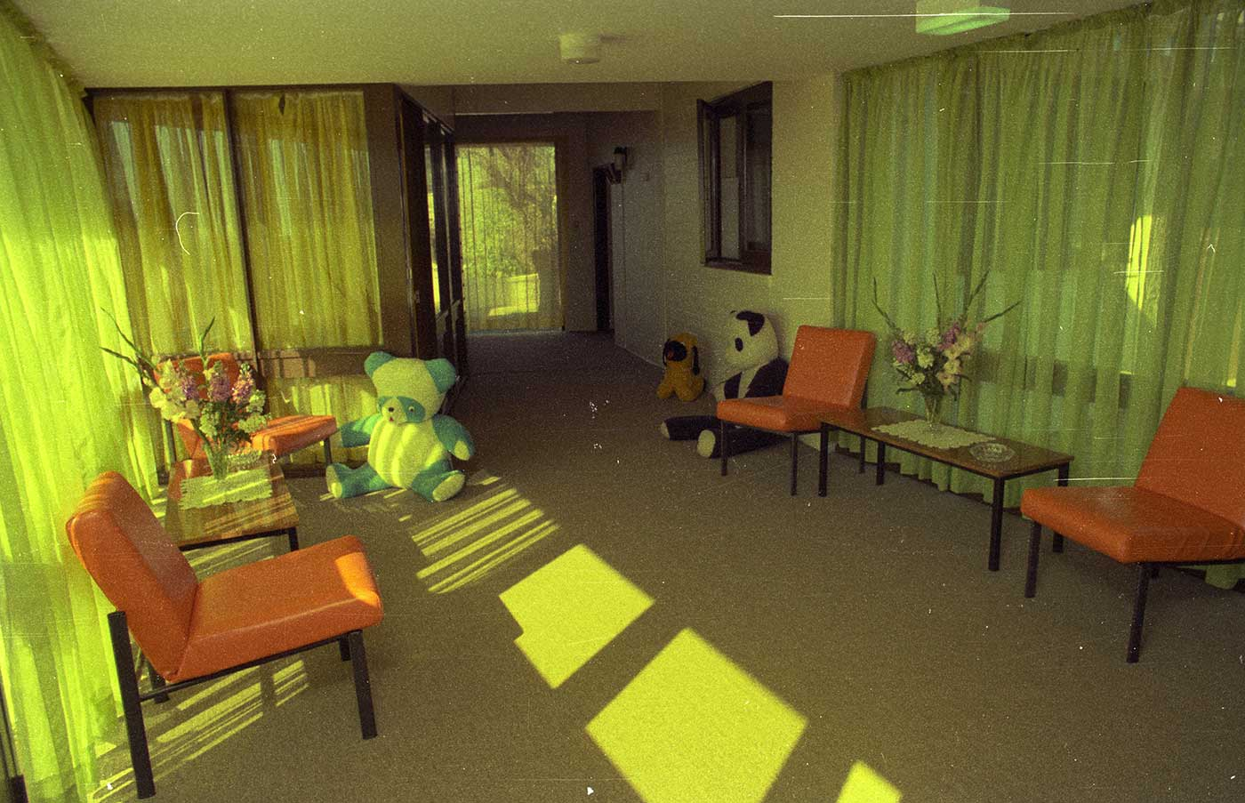 An empty playroom with chairs and large stuffed animals. - click to view larger image