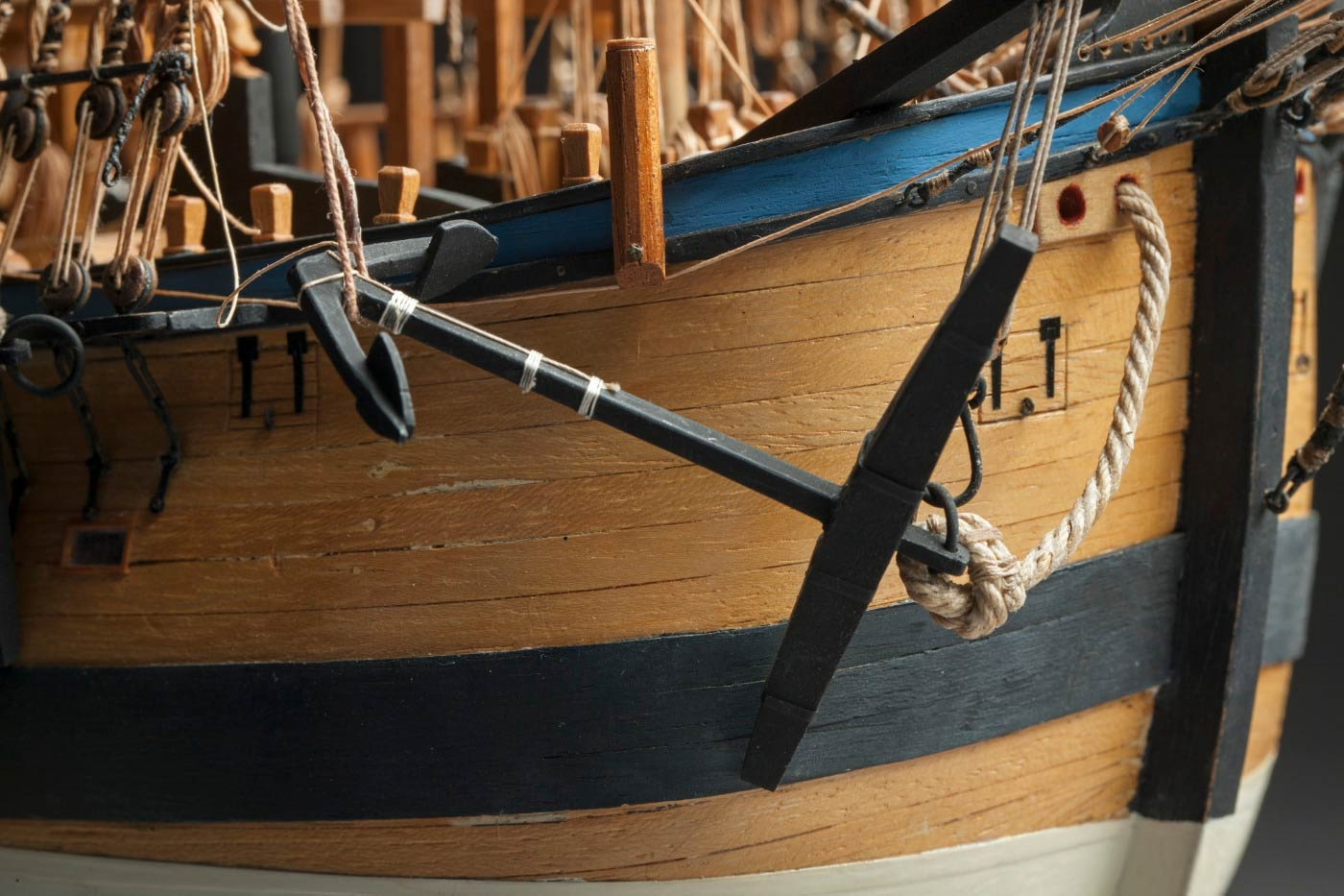 Detail image showing an an anchor at the side of a ship.  - click to view larger image
