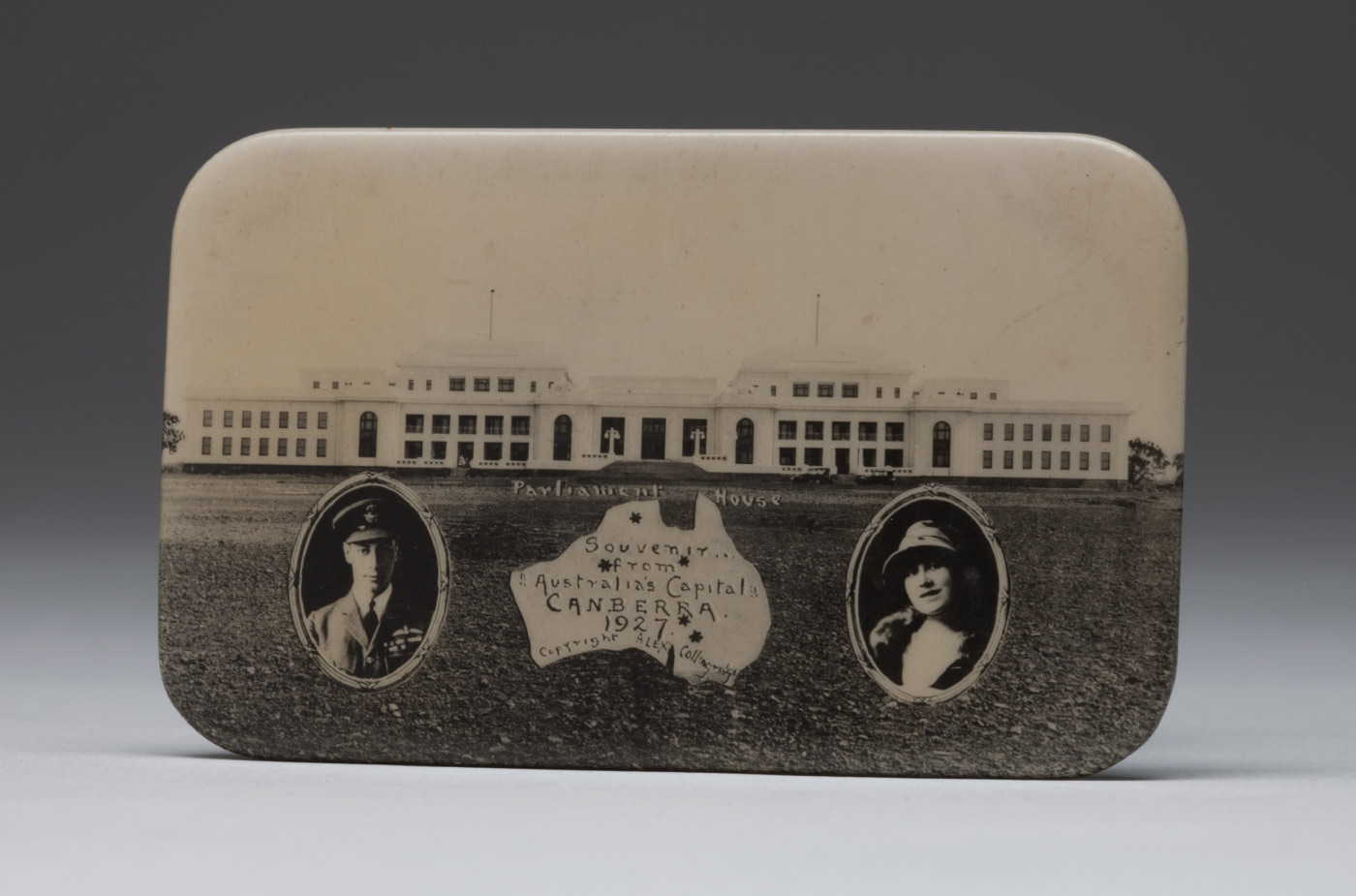 The back of a metal mirror depicting Provisional Parliament House, portraits of the Duke and Duchess, and a map of Australia. - click to view larger image