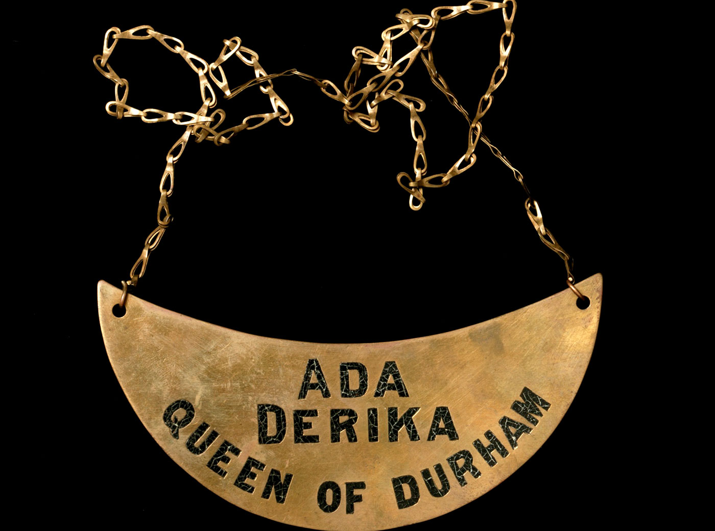Cresent shaped Aboriginal breastplate incscibed: 'Ada Derika, Queen of Durham' - click to view larger image