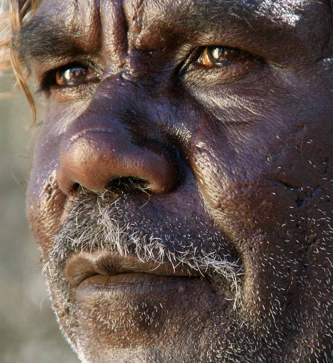 Portrait of Richard Yukenbarri (Yugumbari) Tjakamarra. - click to view larger image