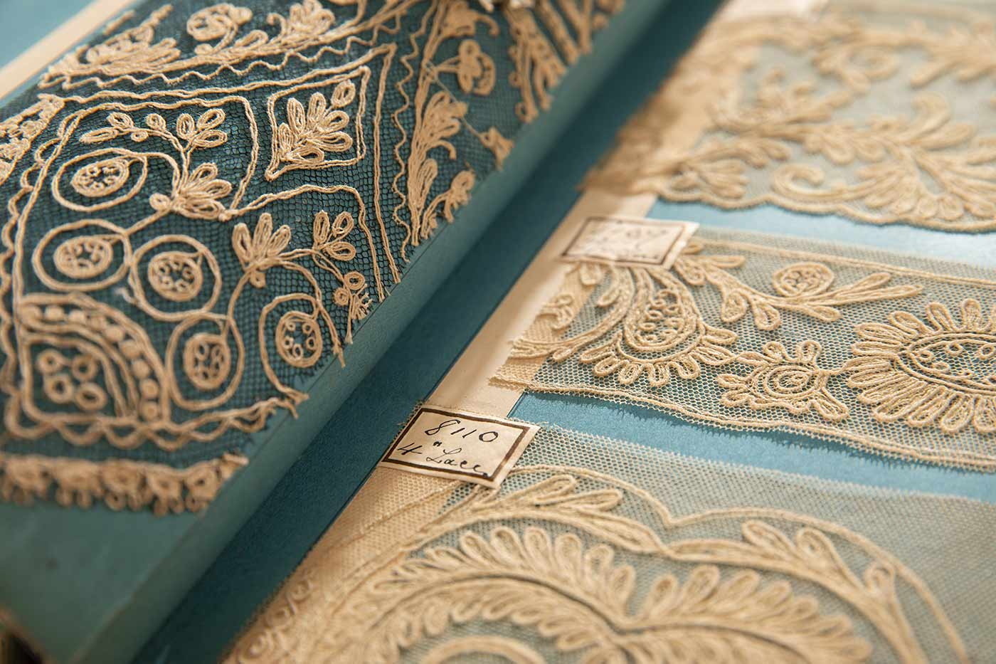 Colour photograph of detail of lace samples. - click to view larger image