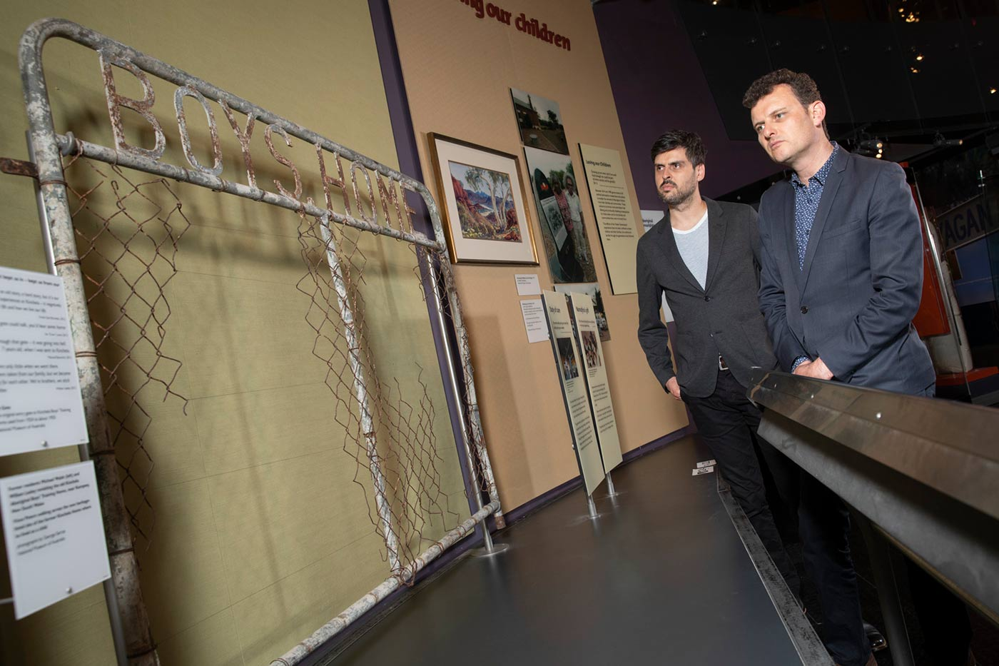 Slava and Leonard Grigoryan inspect a detached old gate on display.