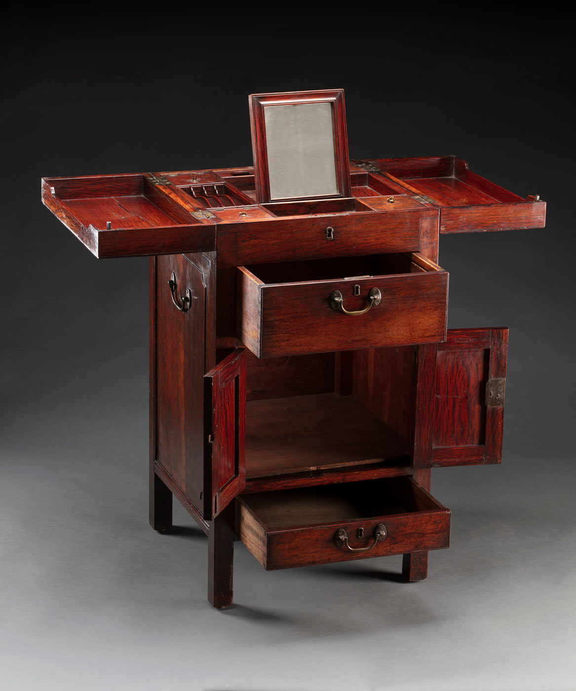 Wooden dresser table with multiple compartments. - click to view larger image