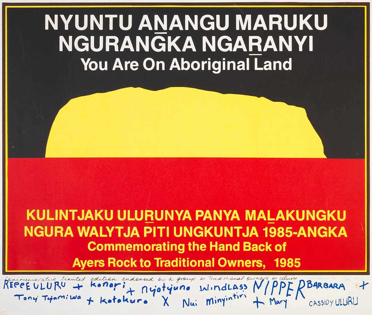 A limited first edition print poster similar in design to the black over red Aboriginal flag, but the sun in the centre has been replaced by a yellow silhouette of Uluru (Ayers Rock).