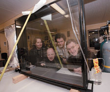 Conservators Robin Tait, Peter Bucke, David Hallam and Eric Archer with the new exhibition case for the John Batman Land Deed.