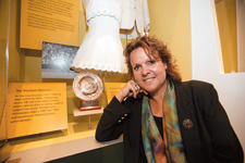 Evonne Goolagong Cawley in front of a display dedicated to her sporting achievements in the Nation gallery.