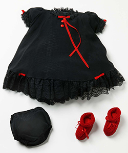 Small black dress with black lace trim at the neck, arms and bottom. Also has two thin red ribbon bows at the bottom and on the arms. Includes matching black bans and a pair of knitted red booties with red ribbon ties at the front.