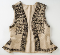 Cream coloured waistcoat with black embroidery.