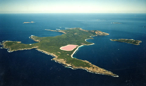 Aerial image showing a group of vegetated islands surrounded by blue ocean.
