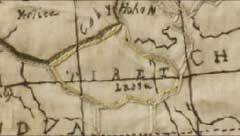 Detail of the front section of an embroidered map of the eastern hemisphere of the world that shows rows of coloured stitches