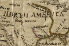 Detail of an embroidered map sampler of the western hemisphere of the world that shows how the maker has chosen to highlight some geographical features such as rivers, mountains and lakes by picking them out in coloured couching and chain stitch