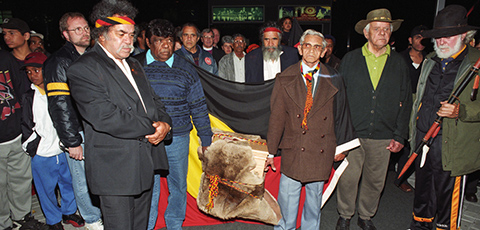 Noongar delegation bringing Yagan's remains back to Australia through Perth airport in 1997