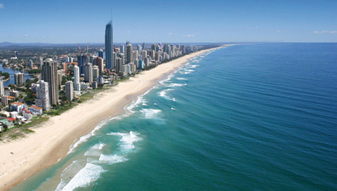 Arial view of the Gold Coast showing the strip of beach and high-rise buildings