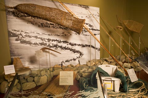 First Australians display featuring fishing equipment.