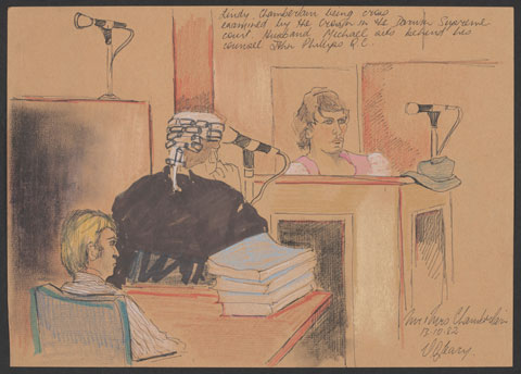 A seated woman wearing a pink and white top gives evidence in a courtroom. A man in a wig and black legal robes looks at the woman. Behind him sits a blonde-haired man wearing a striped shirt.