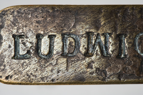 Close up image of the 'LUDWI' lettering on the Leichhardt nameplate.