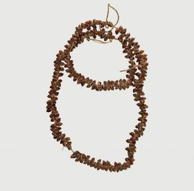 Necklace consisting of small brown snail shells arranged on a string.