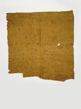 Thin single-layered of barkcloth dyeda  yellowish colour, stained with red patterns consisting of dots and semicircles.