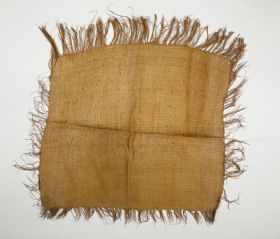 Hand-woven cloak made of flax with a fringed edge.