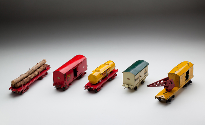 (l-r) Victorian Railways timber wagon, large goods van, tank wagon, small goods van and crane wagon, made from sheet steel and cast metal components by Ron Titchener and associates