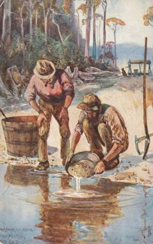Colour illustration of two men working beside a waterway. One man crouches, holding a shallow pan over the water. The second man stands, smoking a pipe, watching the pan.