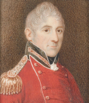 three-quarter profile portrait painting of smiling middle-aged man with grey, curly hair wearing the dress uniform of a senior army officer – red tunic with black collar and gold epaulettes.