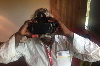 A man looks into a virtual reality headset