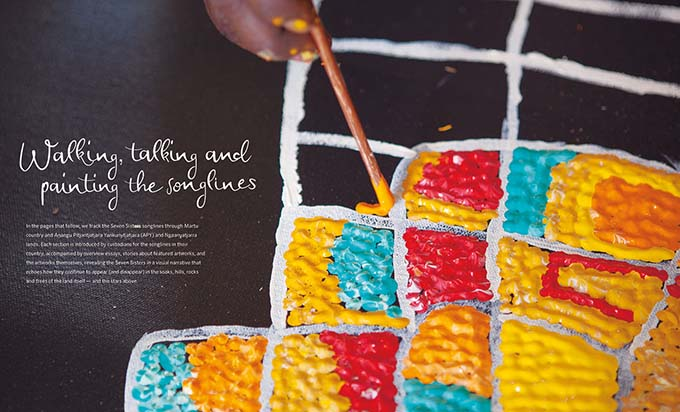 Songlines catalogue spread with text 'Walking, talking and painting the sonlinges' and a large detail image of a paintbrush on a canvas