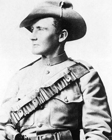 Black and white photo showing Morant from the waist up. He is in uniform with bandolier and slouch hat, face turned to his right