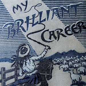 Cover shows illustration of a woman on a horseback charging towards flock of sheep cracking a whip. The title is included but not the author.