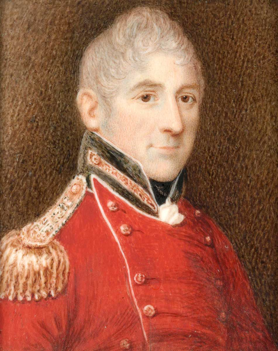 three-quarter profile portrait painting of smiling middle-aged man with grey, curly hair wearing the dress uniform of a senior army officer – red tunic with black collar and gold epaulettes. - click to view larger image