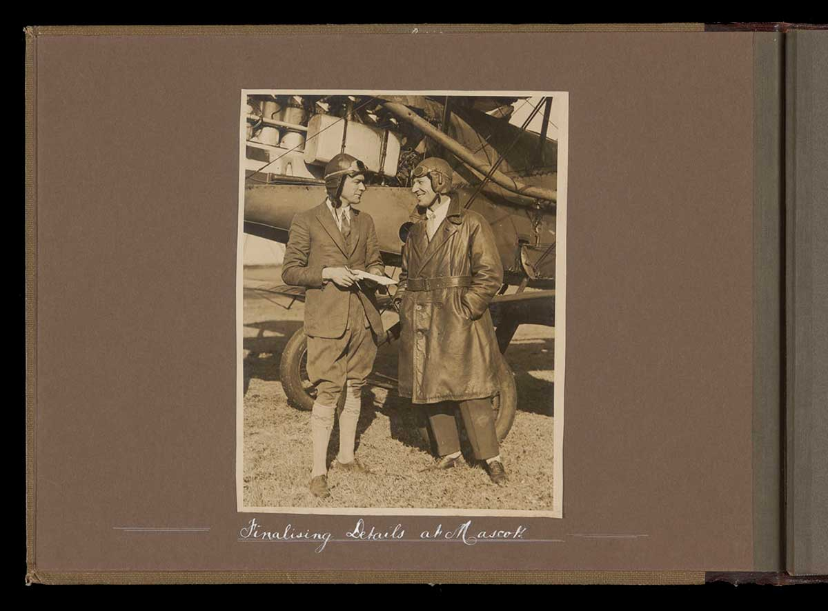 Kingsford Smith and Ulm standing beside their plane. - click to view larger image