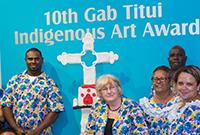 Gab Titui staff holding an award