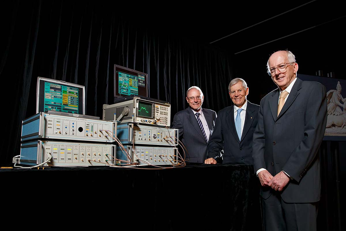Scientists who contributed to CSIRO's wireless invention (from left) John O'Sullivan, Terry Percival and Graham Daniels, at the media event to announce the prototype's inclusion as the 101st object the exhibition A History of the World in 100 Objects. - click to view larger image